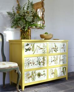Bring untamed natural accents into your home with a decoupage dresser embellished in all manners of festive flora. Picturesque paper cutouts are pasted onto the face of an unadorned dresser and sealed with varnish for an eye-catching complement to any room design.
