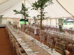 Just add Small trees as decoration to re-create this elegant Country style for a Summer Wedding. Cool and understated it works so well in the airy space of a traditional canvas pole tent.