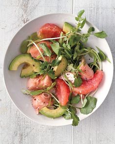 This satisfying salad combines crisp greens, such as watercress or sunflower shoots, with juicy citrus, rich avocado, and silky salmon. Plus, it has three sources of heart-healthy fat. #marthastewart #recipes #recipeideas  #seafoodrecipes #seafooddinners #seafood Poached Salmon, Spicy Salmon, Pan Seared Salmon, Grilled Salmon, Baked Salmon Recipes, Fish Recipes, Seafood Recipes, Dinner Recipes, Eating Clean
