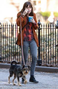 Something sweet: Dakota Johnson was seen tucking into some frozen yoghurt as she took her ...