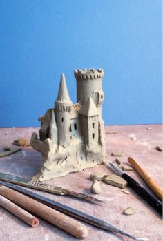 Progress on a Castle that will go onto a bowl. The plan here will be to create a landscape modelled completely around the outside wall of a large bowl. The Castle on a cliff has a winding road leading from it that moves around the bowl …over a bridge and through a small village …and into a wood which leads back to …the Castle. This bowl can be a bowl for fruit or whatever …or as a large yarn bowl with hook holder in the round tower. To be completed sometime next week. Further photos will…