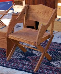 This one folds up by removing two pins (if I could pad this nicely, this would be a great camp chair)