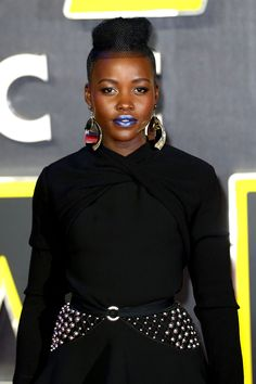 At tonight's London premiere of Star Wars: The Force Awakens, actress Lupita Nyong'o got into the sci-fi spirit with a bold blue statement lip.