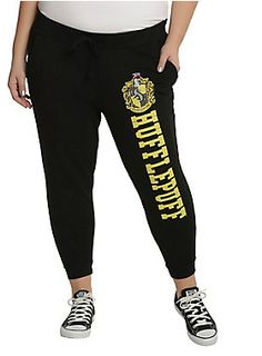 """<div>Curl up for your next <i>Harry Potter </i>marathon in these super comfy Hufflepuff joggers. The black elastic drawstring waist joggers feature the Hufflepuff house crest and logo down the left leg, pockets and elastic cuffs.</div><div><ul><li style=""""list-style-position: inside !important; list-style-type: disc !important"""">100% cotton</li><li style=""""list-style-position: inside !important;..."""