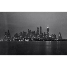Lower Manhattan skyline at night, seen from either the Staten Island Ferry or Governor's Island, in February of 1938. (Bofinger, E. M./Courtesy NYC Municipal Archives) #