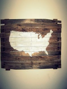 I wouldn't do a map but love the idea of a picture painted on a pallet for deco