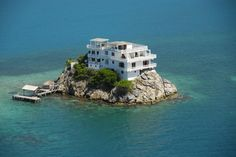 Luxury villa-hotel at Dunbar Rock (Central America, Honduras) situated on top of the 10-meter cliff half a kilometer from Guanaja Island. On three floors are 6 bedrooms, water and electricity supply were laid to the island on the ocean floor.