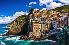 "Cinque Terre (pronounced CHEEN-kweh TEHR-reh), which is a UNESCO World Heritage site, is comprised of five adjacent towns along the Ligurian coast in northern Italy. The ""Five Lands"" (as it's name translates) are Monterosso al Mare, Vernazza, Manarola, Corniglia and Riomaggiore, each equally beautiful and like visiting a living postcard"