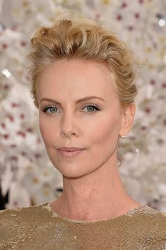 Charlize Theron Loose Bun - Charlize Theron topped off her 2014 VMA look with a lovely loose bun.