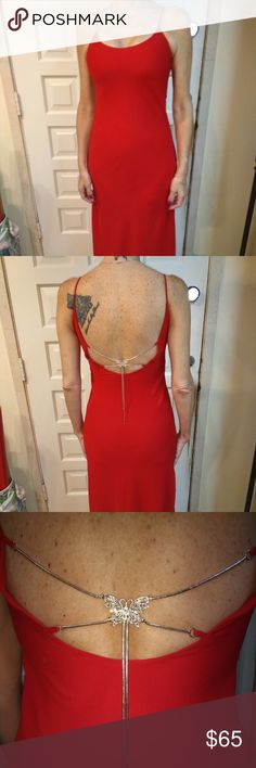 Vintage Ruby Red Gown w/Silver Chain Accent Gorgeous vintage gown with an amazing butterfly silver accent back detail chain.  I'm a size small to medium but I'm a 36D and this is meant more for a C or B.  Never got to wear this beautiful piece.  Make offer. Dresses Maxi