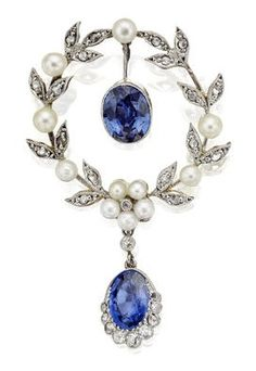An Edwardian sapphire, pearl and diamond brooch, circa 1905. In the form or a wreath set with rose-cut diamonds and pearls, suspending an oval-cut sapphire swing drop and terminating in an oval-cut sapphire with a graduated rose and old round brilliant-cut diamond border.