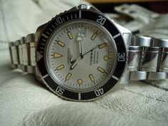 http://forums.watchuseek.com/f405/pics-my-new-20-year-old-longines-5-star-admiral-diver-792335.html