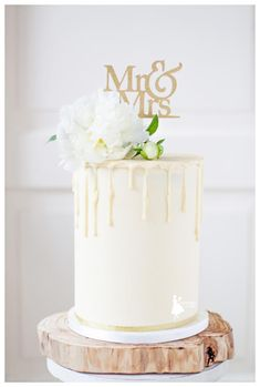 Buttercream double barrel wedding cake with drips - Cake by Taartjes van An (Anneke)