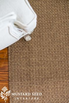 a rug that looks like jute or seagrass, but is a made of a synthetic material that doesn't shed, unravel, from Decor Steals
