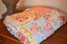 Shabby Chic Rag Quilt, Favorite, blue, pink, yellow, green, & soft red with ivory colored baking.. $360.00, via Etsy.