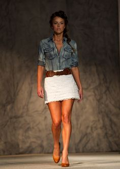 A JHaus model on the runway during Omaha Fashion Week.  By: MARK DAVIS/THE WORLD-HERALD