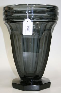 An Art Deco Val St Lambert grey tinted glass vase, the horizontally cut rim above a faceted tapering body and octagonal foot, acid etched factory mark to base, height approx 28cm