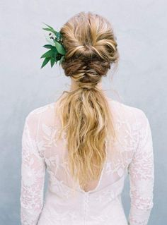 Half up half down wedding hairstyle with green leaves