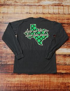 "Does your man love deer season too much? Shout it loud that you want to be loved more than deer season in this awesome long-sleeve, front pocket, comfort colors ""love me like you love deer season"" t-shirt!"