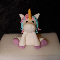 This adorable unicorn topper measures about 3 inches tall and made of fondant. There are wooden skewers inserted for stability and it comes from a kitchen that uses nuts. Please contact me with any customizations. I always ship priority mail, which generally only takes 2 or 3 days ship time, but the post office does not guarantee it. Please order at least 2 or 3 weeks in advance of your event to allow for ample shipping time.