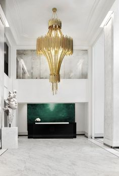 Golden chandelier for a magnificent luxury hotel lobby! Feel inspired: www.luxxu.net | #interiordesign #luxuryhotels #lighting
