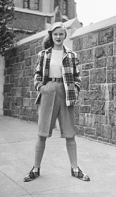 College girl with matching plaid pixie shoes.  1946 by Nina Leen.