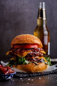 Bourbon basted cheese burgers topped with caramelized red onions. Click for recipe. simply-delicious-food.com