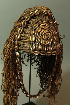 Africa | An elders hat from the Lega people of DR Congo | Mid 20th century.| Decorated with cowrie shells , fine strands of raffia and early glass beads