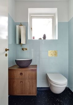 A designer favorite, this versatile light blue tile offers a cool color palette refresh. Bathroom Toilets, Laundry In Bathroom, Bathroom Inspo, Bathroom Inspiration, Washroom, Bathroom Ideas, Blue Bathroom Interior, Modern Bathroom, Small Bathroom