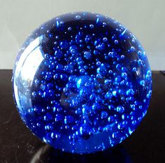 I have one of these already - a bit bigger - but I'd love one in a different color - like purple....   Blue Glass Paperweight Controlled Bubble Art Glass Larger