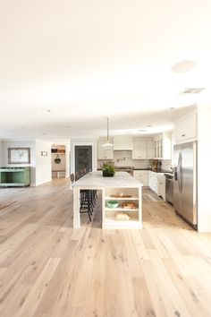 Kitchen. Custom oversized island with ample bar stool seating - as featured on 'Rafterhouse' pilot episode on HGTV.