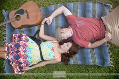 Engagement photography with a blanket and a guitar... love this Anthropologie style photo shoot with bride and groom to be laying on blanket with a guitar... wedding will be at a rustic camp style wedding venue in NH and we're super excited!  #picnicengagement #musicengagementphoto #blanketengagement #bestengagementphoto