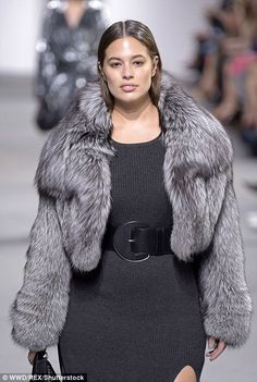 Less is more: Ashley Graham didn't wear any jewellery on the runway, letting her fur coat ...