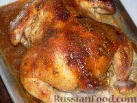 Фото к рецепту: Курица в медово-чесночном соусе, запеченная в духовке