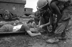 In memory of Vietnam War    A medic lights a cigarette for Spec/5 Gary Davies of Scranton, Pa., awaiting evacuation by helicopter from Ben Het in South Vietnam where he was wounded, June 27, 1969. (AP Photo/Oliver Noonan)