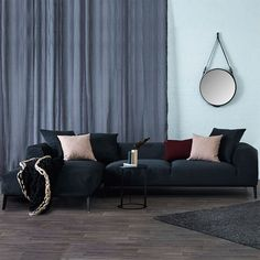 The Danielle charcoal navy chaise lounge is a modern sectional and corner sofa inspired by Scandinavian furniture design.