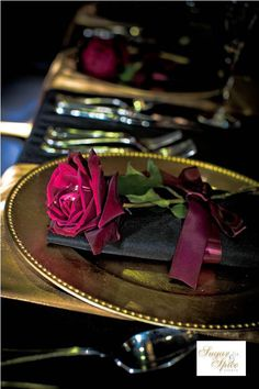 Wedding place setting for black, gold and red colour scheme- i like the look of the single rose. perhaps a different flower?