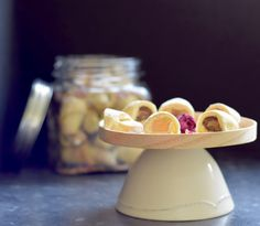 Mini crescent rolls filled with Turkish delight or dates, sprinkled with orange zest and rose petals