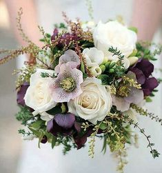Whites Greens and purples bridal bouquet of flowers