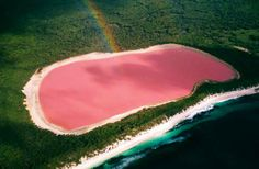"""Lake Retba of Senegal has water that is pink in color! Sometimes it turns purple depending on the effect of sunlight during the day. Rightfully people in Senegal call it """"Lac Rose"""" or the """"Pink Lake"""" Lake Hillier Australia, Pink Lake Australia, Western Australia, Victoria Australia, Lago Retba, Samba Rio, Places To Travel, Places To See, Lakes"""