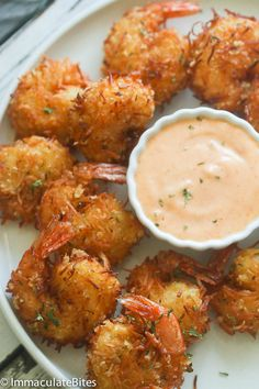 Crispy Coconut Shrimp- Fresh Shrimp dipped in coconut batter , then rolled in an aromatic combination of coconut flakes, breadcrumbs and spices . So Decadent, So Exotic , So Tasty !!  Baked or Fried.