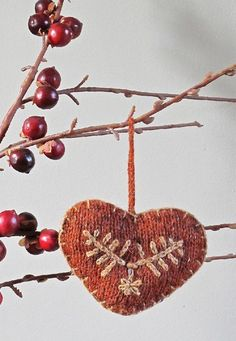 A pretty Christmas tree decoration or a door handle decoration. Easily achievableby the beginner knitter. The embroidery is a simple lazy daisy and chain stitch.