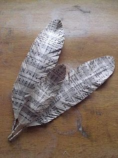 how to make paper feathers.  tuck into Christmas tree.