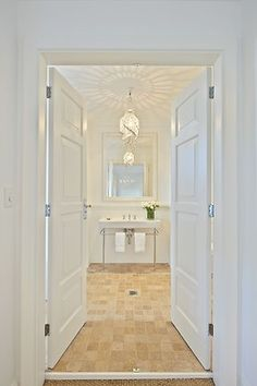 Entrance to a unit bathroom designed by Collette Dinnigan