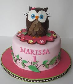 Such a sweet owl themed cake for a little girl's first birthday.