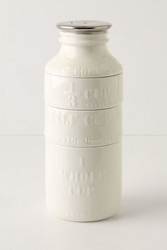 Old-fashioned milk bottle stackable measuring cups. Even prettier inside.