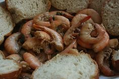 A Year of Slow Cooking: CrockPot Barbecued Shrimp Recipe - This is the best bbq shrimp recipe and it's just like you get for an appetizer in New Orleans.  I have made it several times and I cut out the lemon because it takes over and I only use 1/2 a stick of butter because it will be too oily.  Serve it on french bread and you can't go wrong.  Lots of lovely juice to soak up after.  Mmmm.