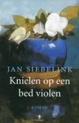Knielen op een bed violen, beklemmend en prachtig!