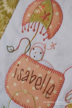embroidery and applique baby quilt by cinderberry stitches