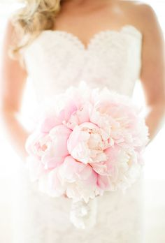 A fluffy bouquet of pale pink peonies, created by Exquisite Linens and Florals, a Massachusetts-based florist.